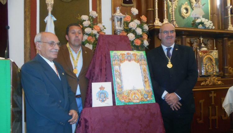 Hermandad de Emigrantes – Presenta su nueva orla de cultos y el escudo del cincuentenario